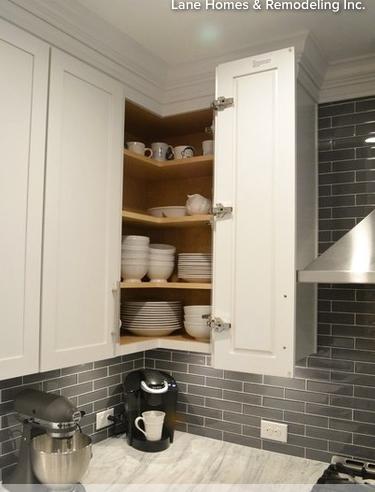 Folding Door Makes Upper Corner Cabinets Easily Accessible Kitchen Cabinet Design Corner Kitchen Cabinet Upper Kitchen Cabinets