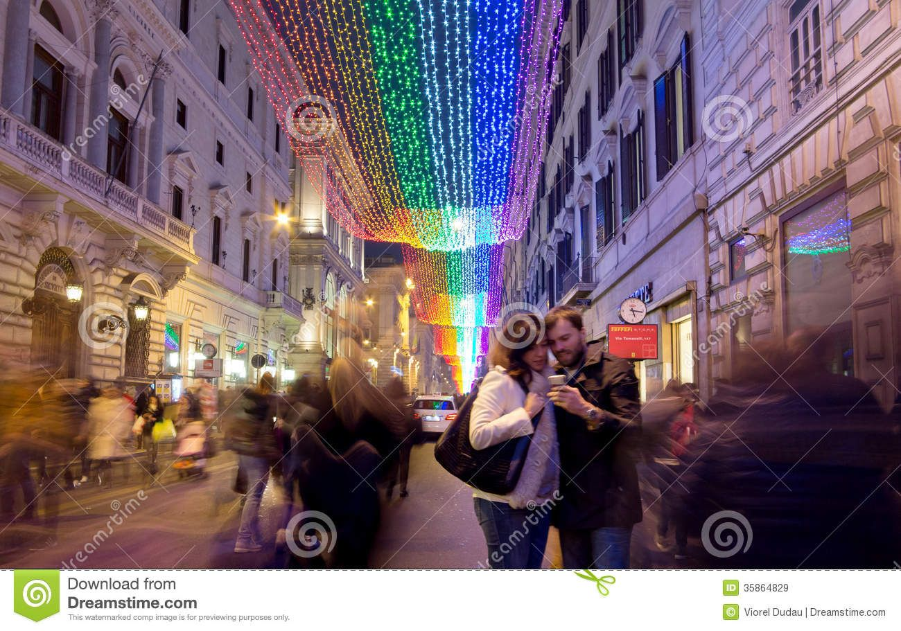 Christmas lights and people on Via del Corso in Rome, Italy.