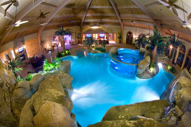indoor tropical pool with fish tank and waterfall by shehan pools screams want