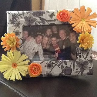DIY picture frame with handmade paper flowers.
