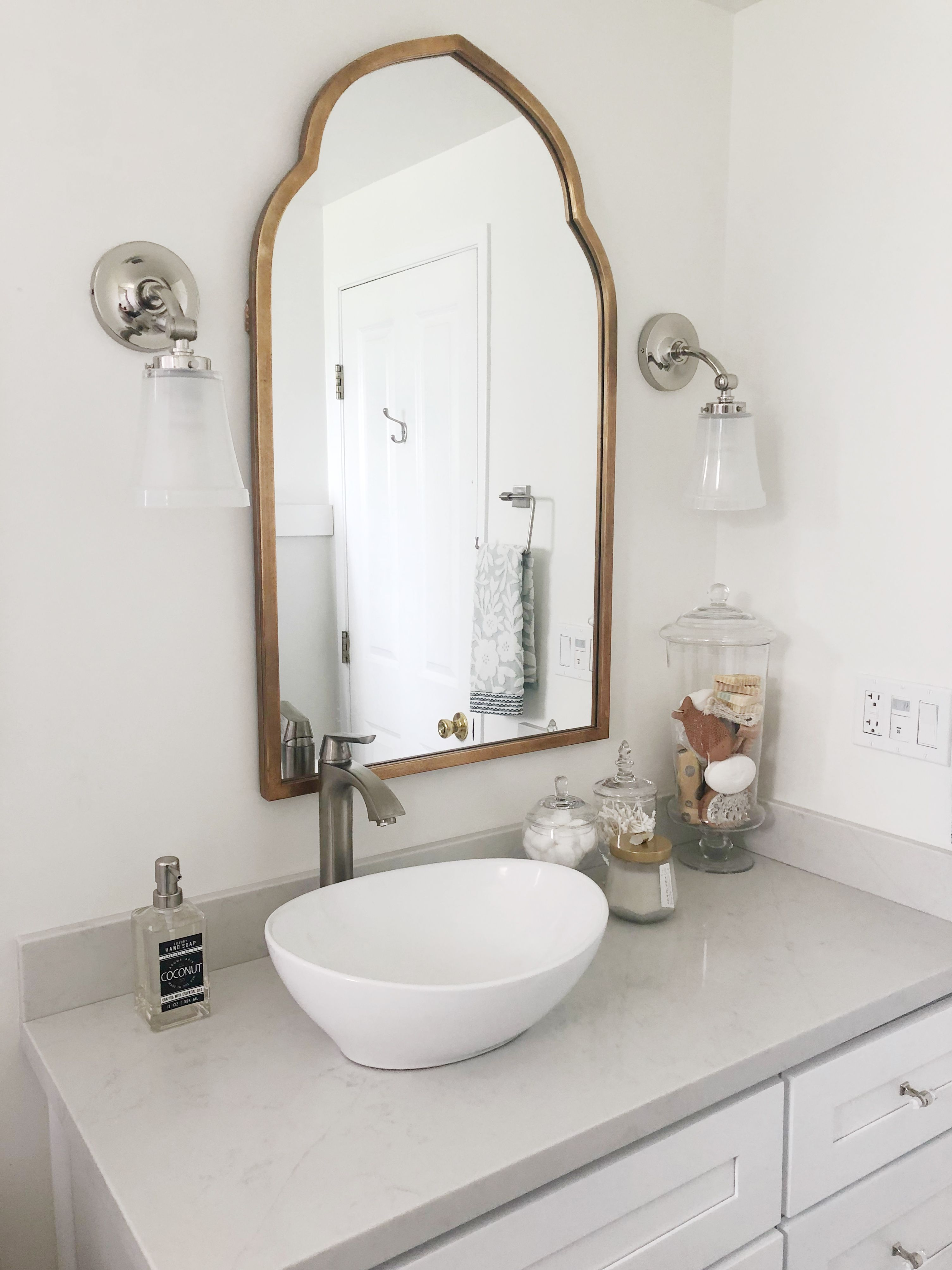Small White And Grey Bathroom Remodel With White Vanity Light
