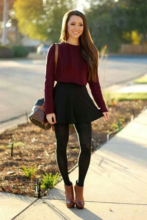 Fall or winter outfit with a wine red sweater, a black skirt, and black  leggings.
