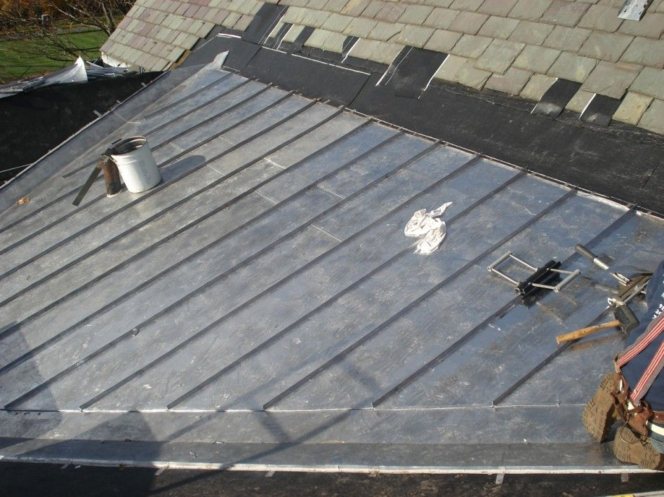 A Standing Seam Lead Coated Copper Roof Next To Slate Roof Repair Slate Roof Copper Roof