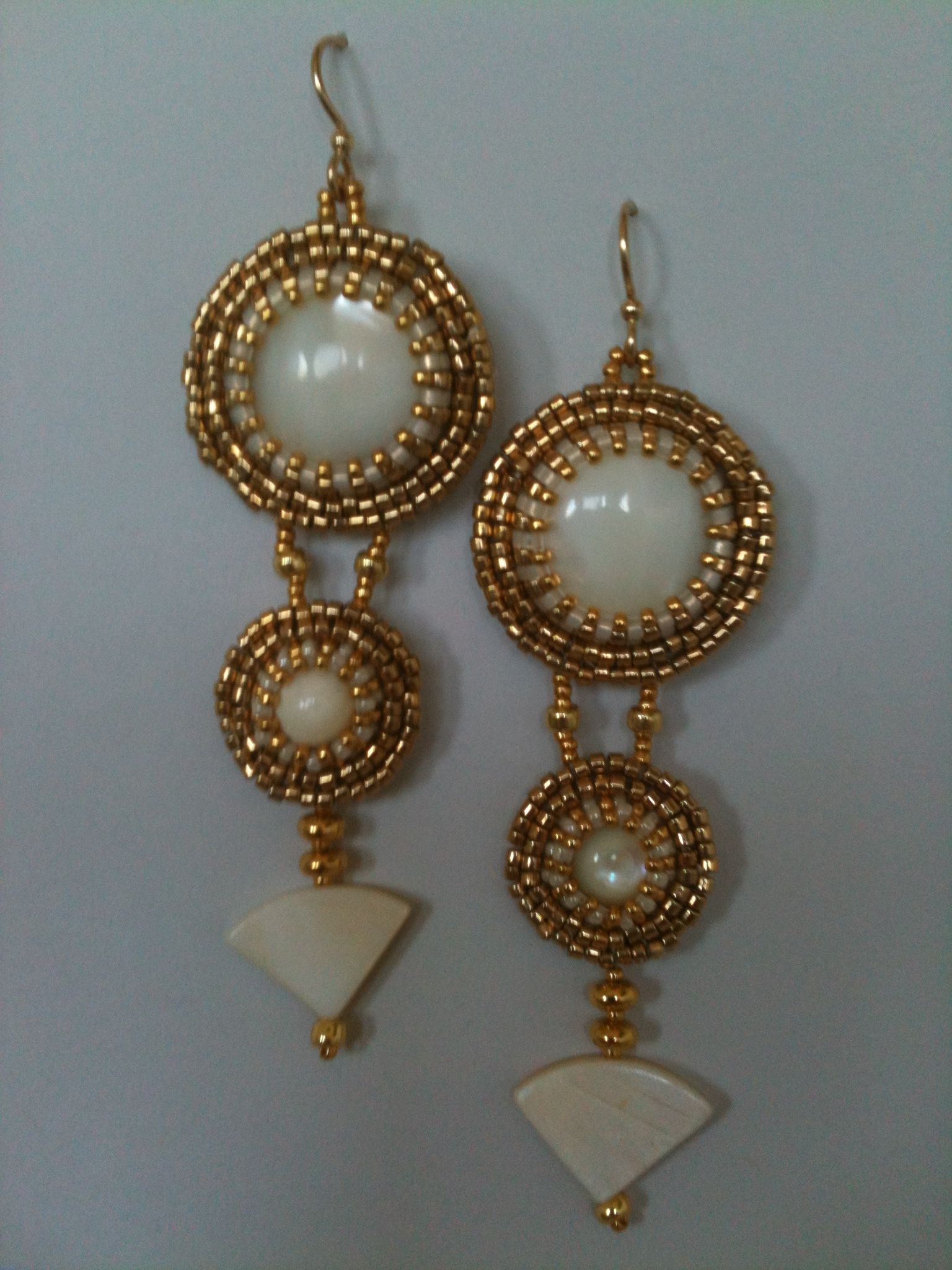 Big mother of pearl & gold earrings by Jeka Lambert.  Bead embroidery.  Mother of pearl cabochons and fan beads, 24K gold plated beads, seed beads.