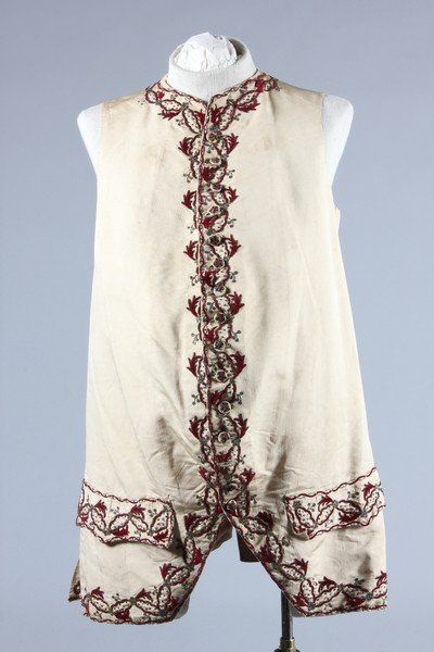 Waistcoat, c. 1760. Ivory silk faille embroidered in wine Chenille and silver thread in chain stitch.