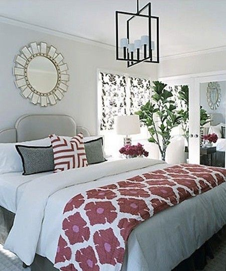 Do a patterned blanket with red accents at end of bed, plain white comforter, grey walls and accent pillows