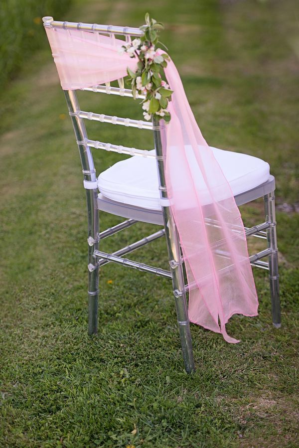 Glamorous and Blossoming Chair Decor with Apple Orchard Blossoms.