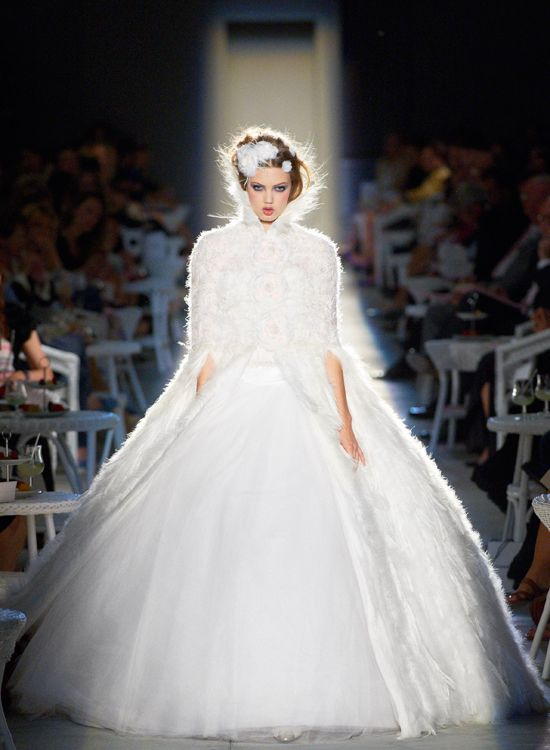 """Chanel Fall/Winter 2012/13 show, including feathered wedding dress with elbow-length sleeves. –From """"Wedding Day Beauty Looks Inspired By Chanel"""" on http://www.weddingbells.ca/blogs/beauty/2012/07/06/wedding-day-beauty-looks-inspired-by-chanel/"""