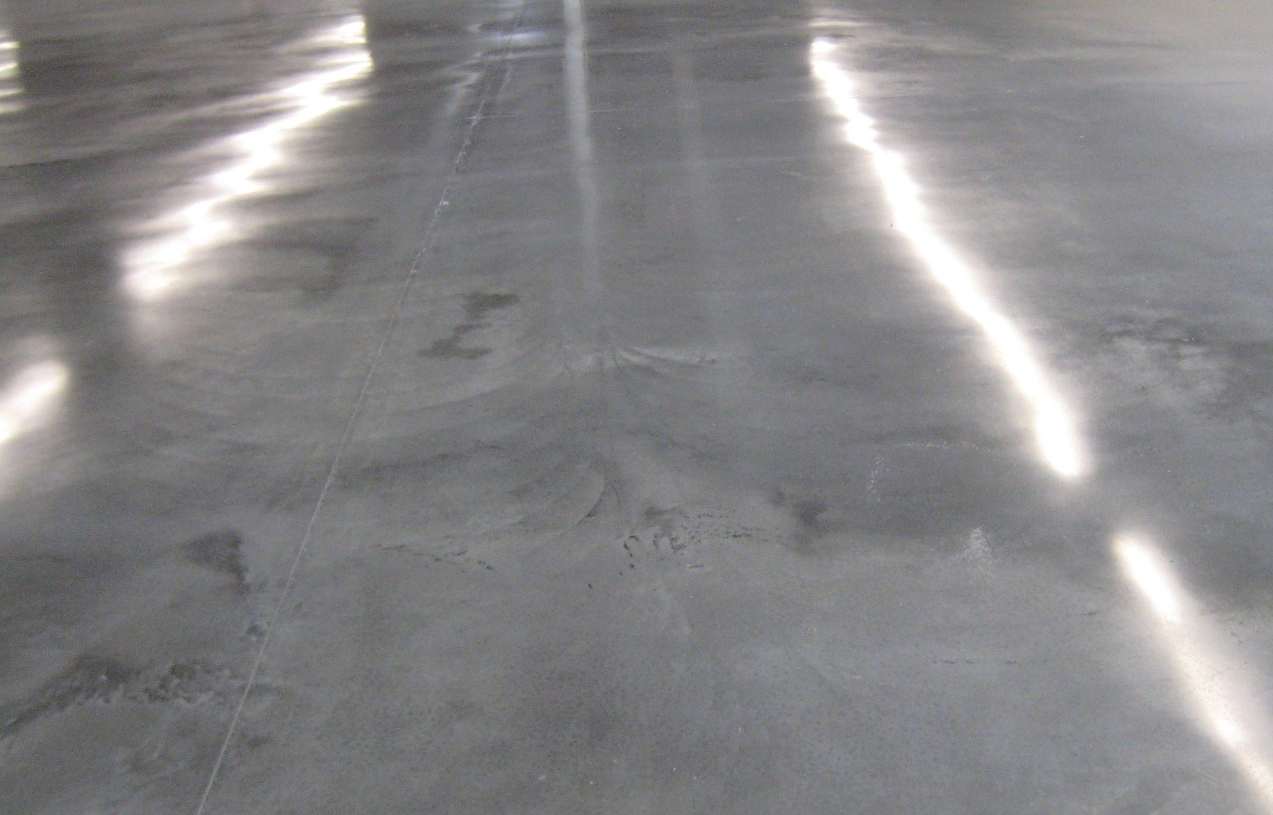 Concrete floor titus restoration concrete floors for Stained polished concrete floor