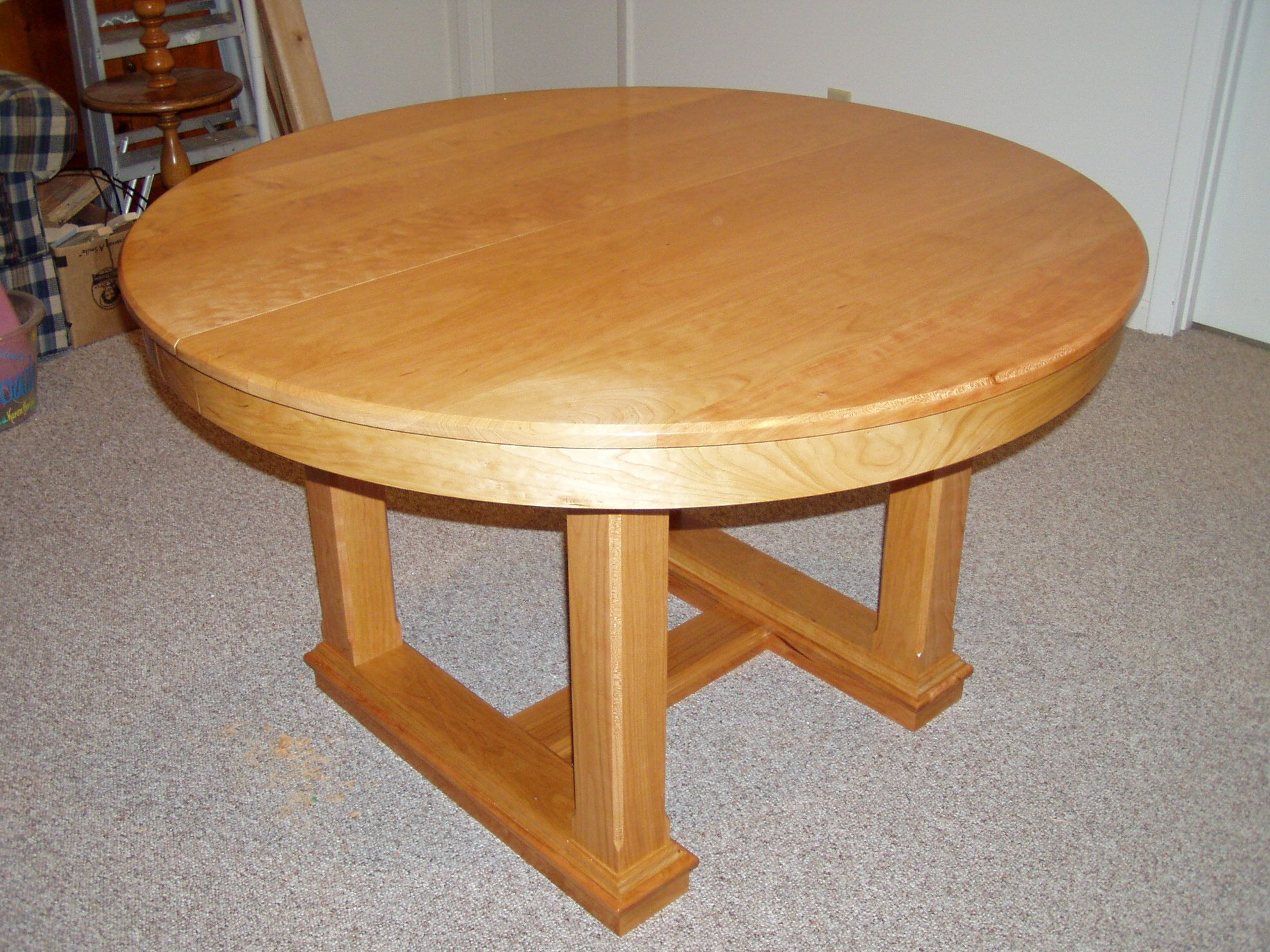 Round Dining Table in Cherry Butterfly Leaf in stored Position