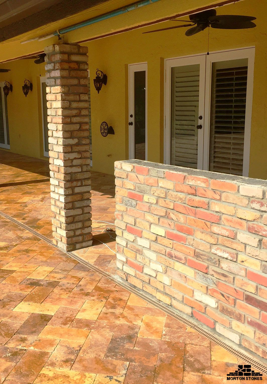 A beautiful home with brick red columns. #mortonstones #brick #tiles ...