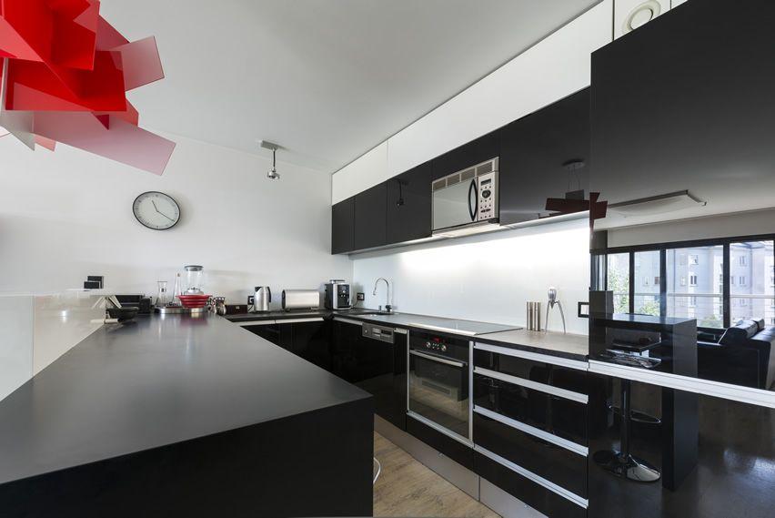 Ultra Modern Black U Shaped Kitchen With Red Art Fixture White Modern Kitchen White Kitchen Interior Kitchen Design Modern Small