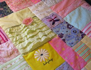 Baby clothes quilt. Cute idea for all the clothes they grow out of!
