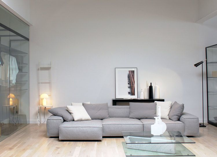 Neowall sofa by living divani on display in our showroom for Showroom divani milano
