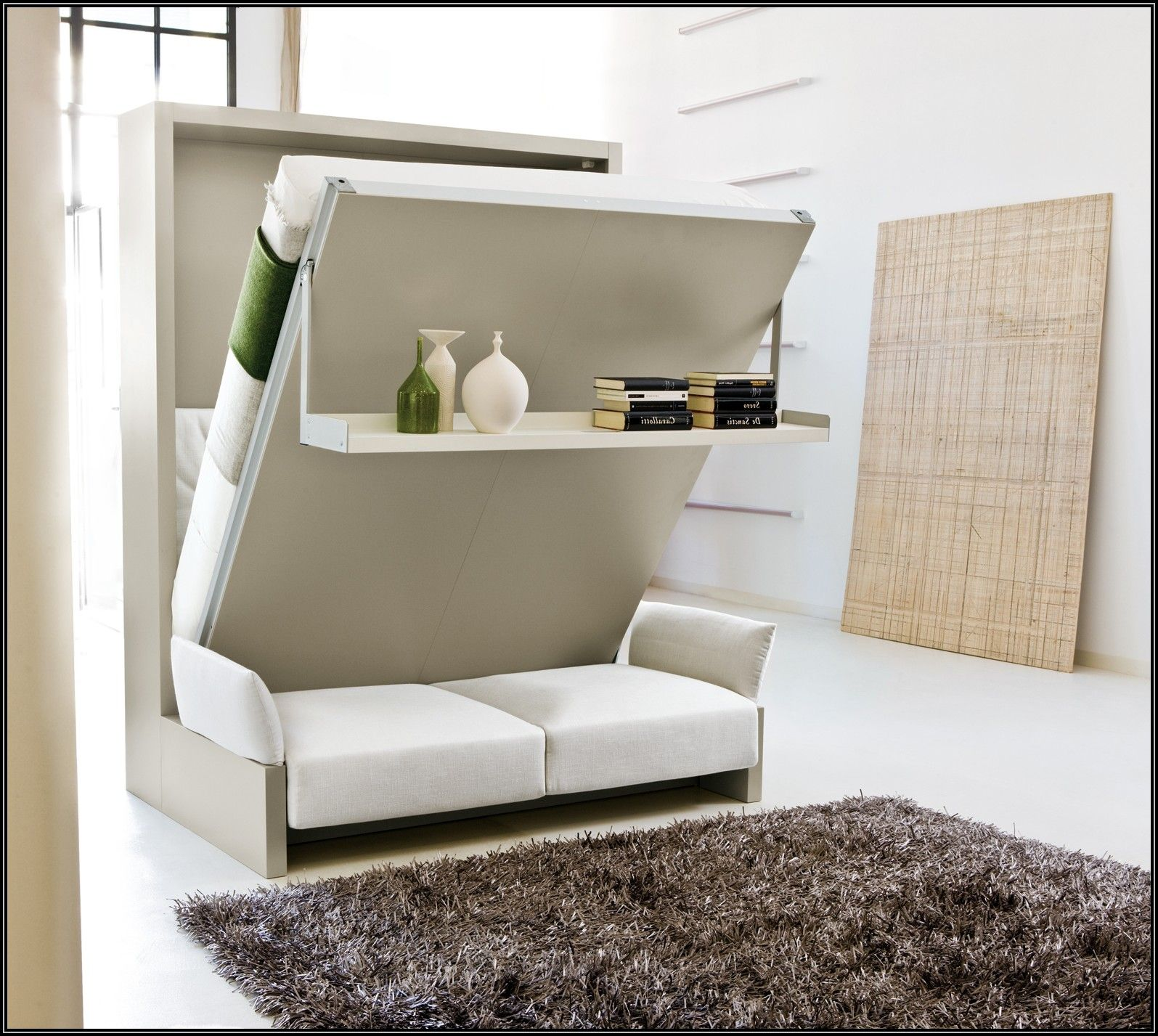 Save Small Space In A Bedroom Using Murphy Bed IKEA Outstanding Ikea With Convertible Sofa Also Shag Rug For Interior Design