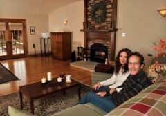 Grace and Jeff Harshbarger relax in their great room, part of the addition they built onto the original 1848 brick home.