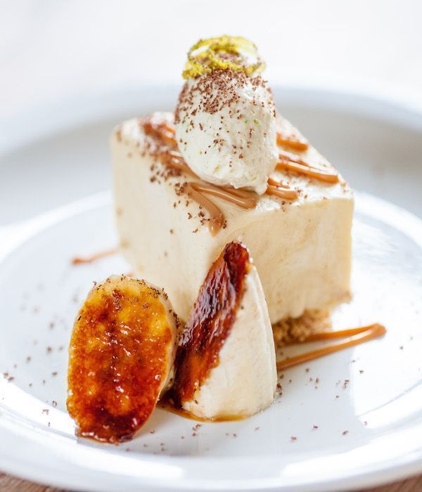 Celebrating the vibrant flavours of the Caribbean, this banana parfait recipe from Dominic Chapman makes a joyful - if slightly naughty - dessert. Commenting on the dish, Chapman says: The UK is a melting pot and so multicultural. This has given us access to ingredients from all over the world. This banana and caramel parfait is something that demonstrates the years of exotic ingredients we have had the pleasure of working with. #fancy Desserts Banana parfait #meltingpotrecipes