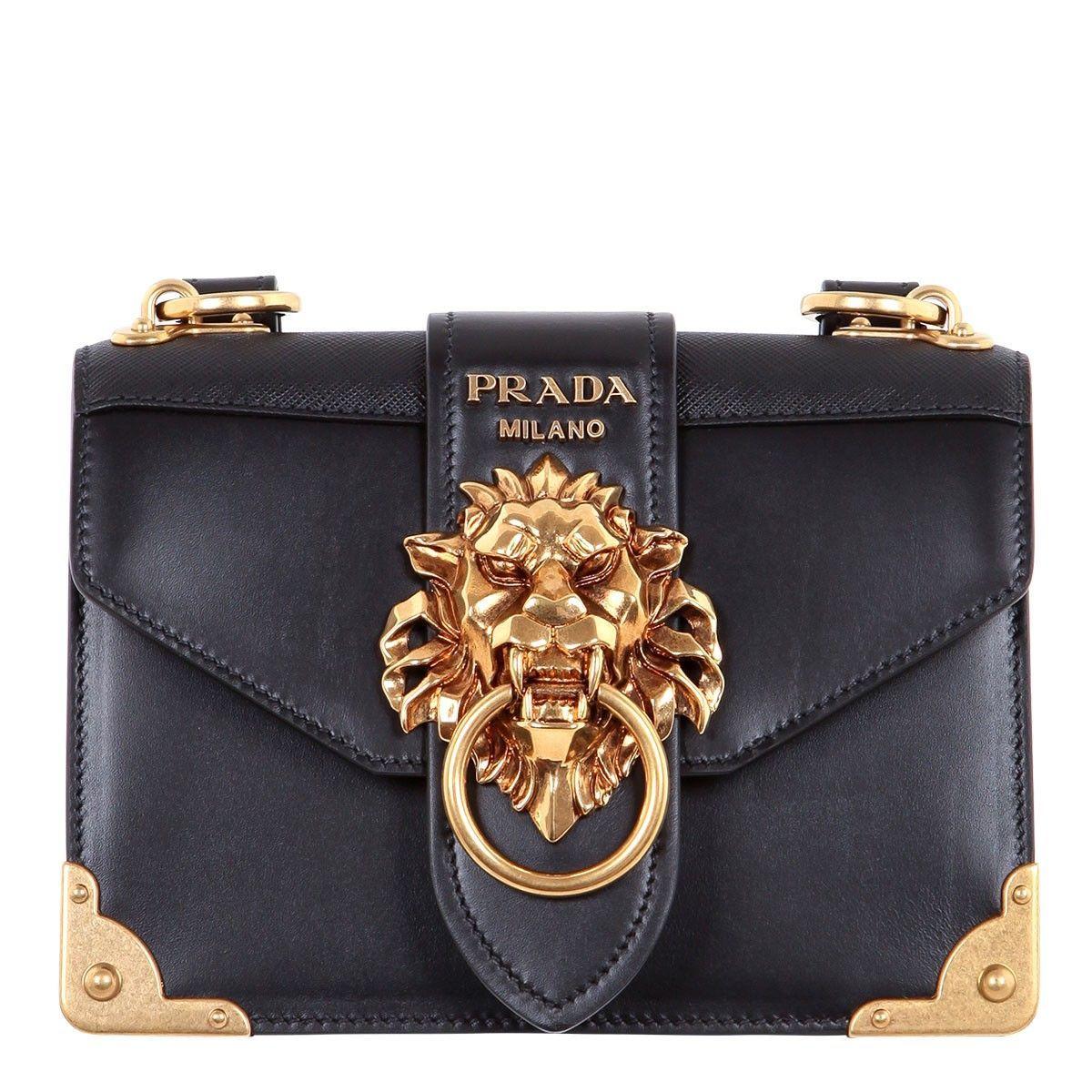 832dc71d7a3b Shop Prada Cahier lion-embellished shoulder bag