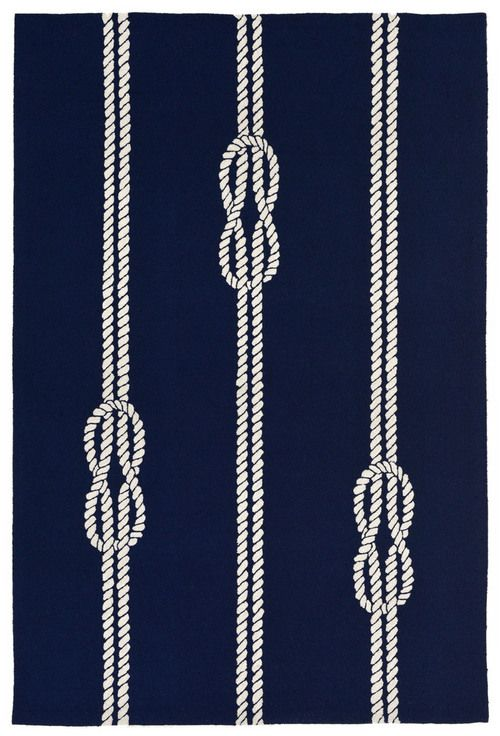 Add sea worthy charm to your beach home with this simple nautically designed Navy Blue Ropes Area Rug, featuring off-white stripes of ropes and knots stretched across a classic dark blue background.