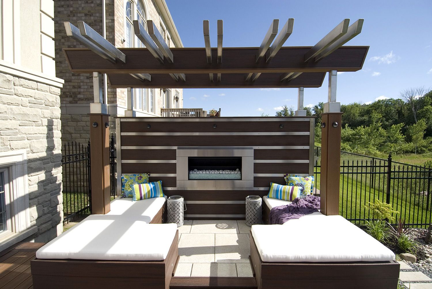 "With two stainless steel pergolas, this deck is a stunner. From ""Decked  Out"" project ""The Fireplace Deck"". Deck Design by Paul Lafrance Design. - With Two Stainless Steel Pergolas, This Deck Is A Stunner. From"