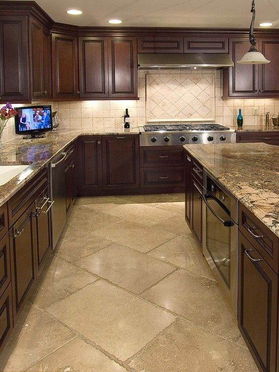Travertine Tile Floor...pretty kitchen but those floors look like high maintenance. I want smooth grout.