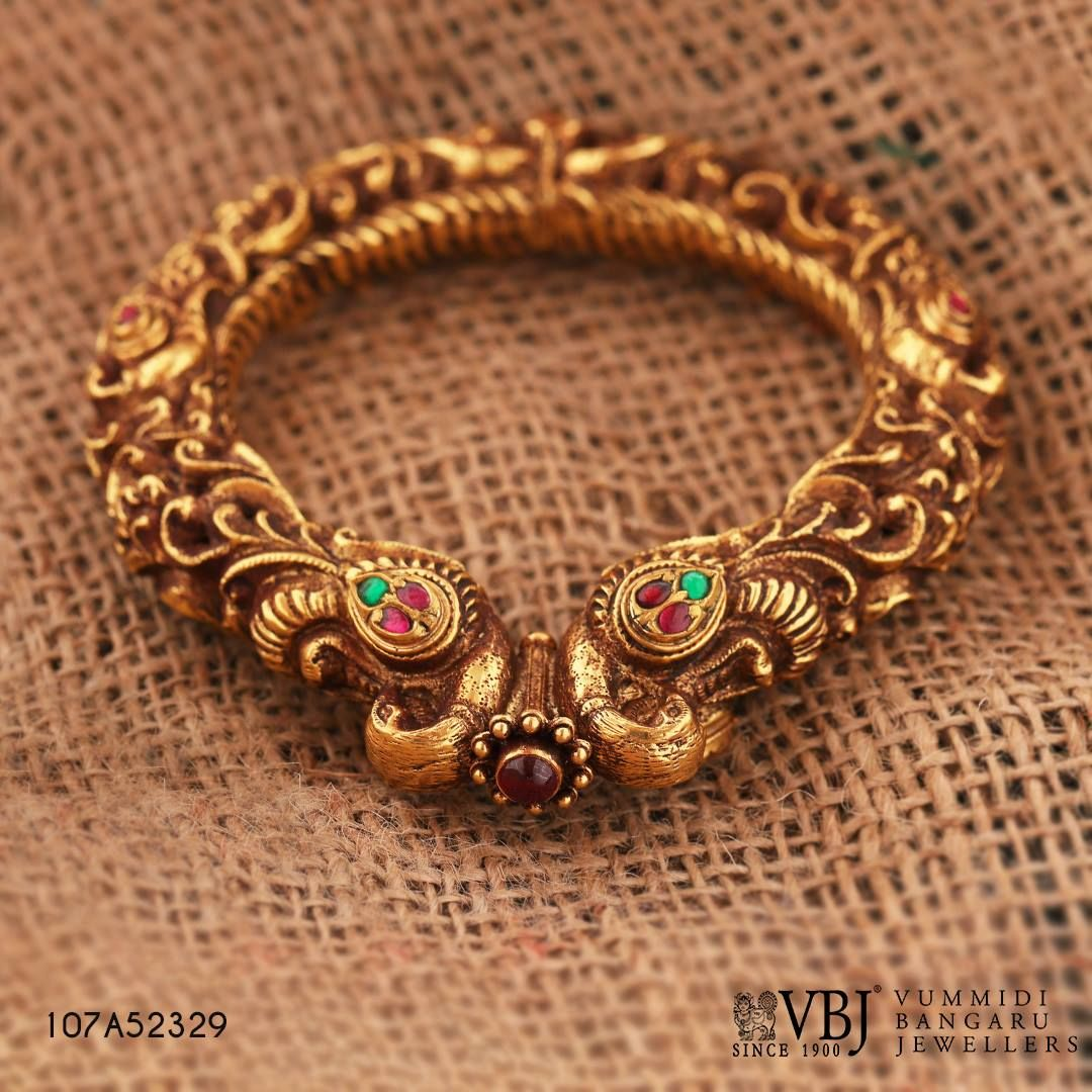 This statementmaking antique kada features intricate details this