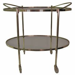 Mid-Century Modern Oval Brass Bar Cart | From a unique collection of antique and modern bar carts at https://www.1stdibs.com/furniture/tables/bar-carts/