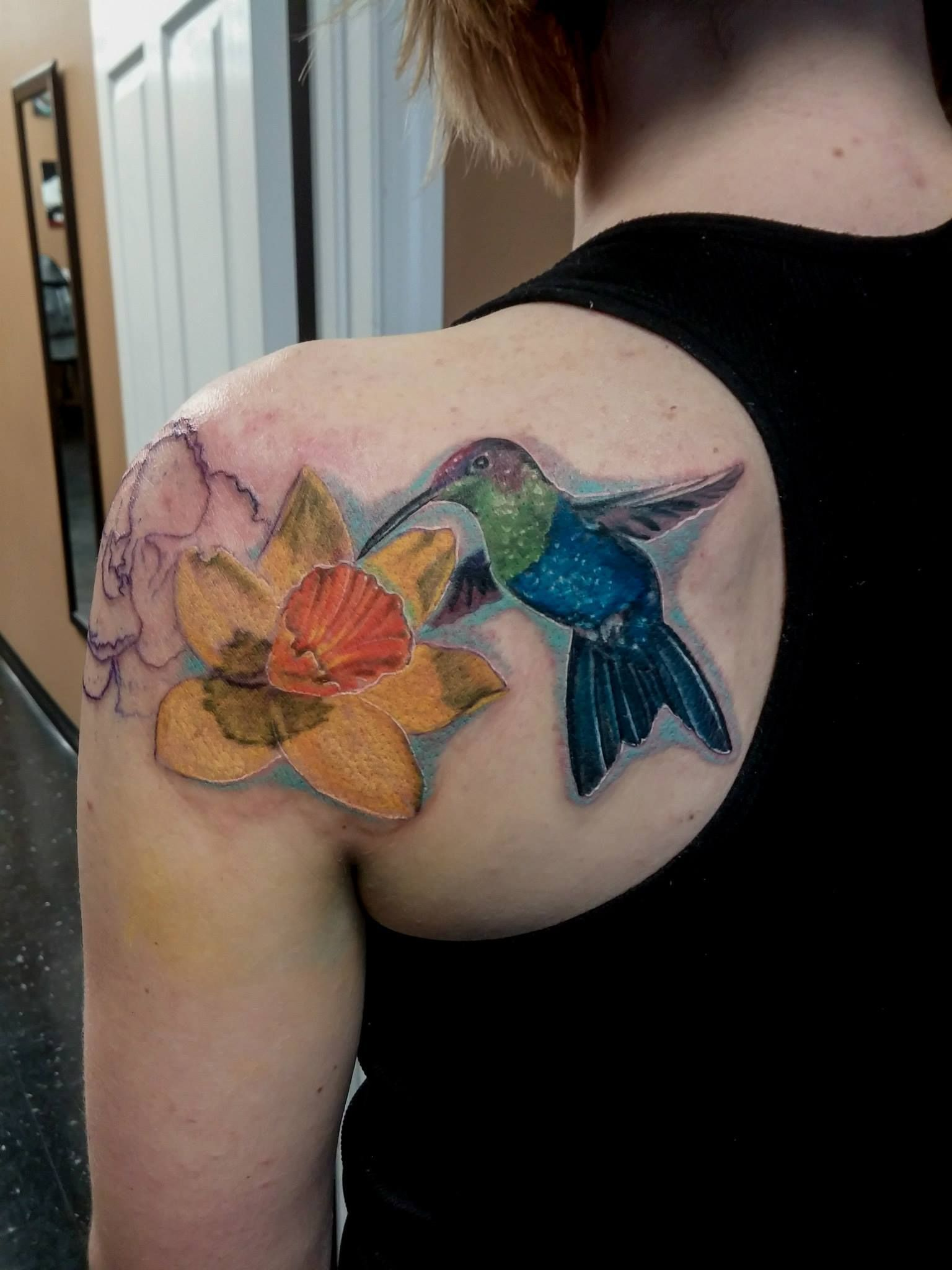 Beautiful hummingbird with flowerwe are a tattoo shop