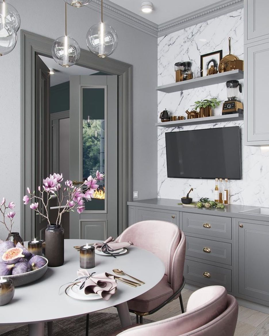 This beautiful grey and blush pink dining space is made