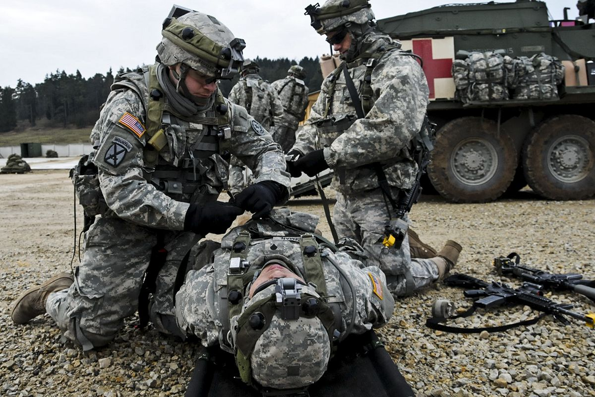U.S. Army medics evacuate casualties to a nearby location during a ...
