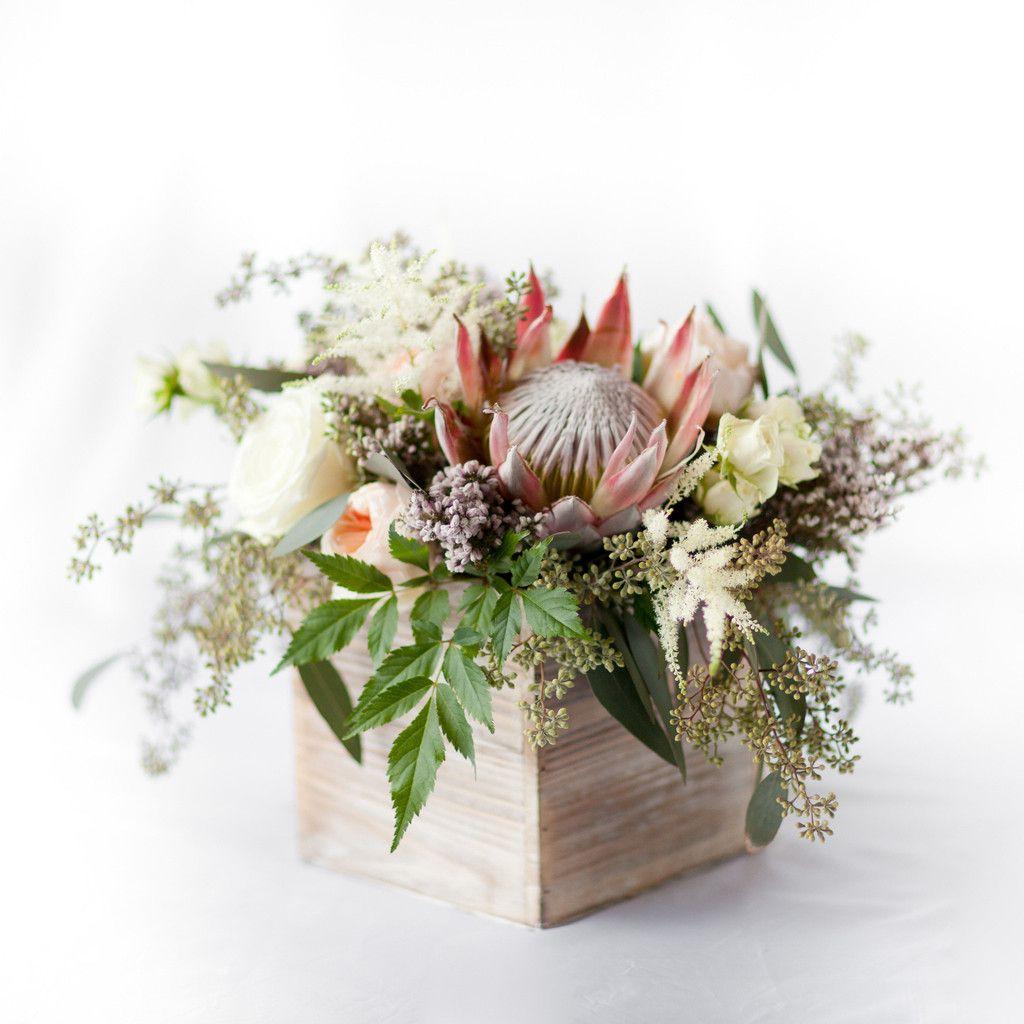 King protea centerpiece pops of plum african queen for King protea flower arrangements