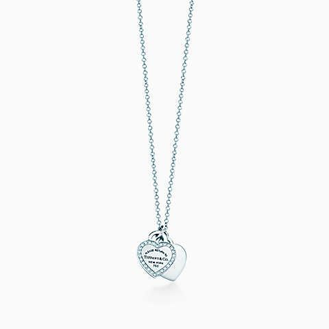 Return to Tiffany™ mini double heart tag pendant in white gold with diamonds.