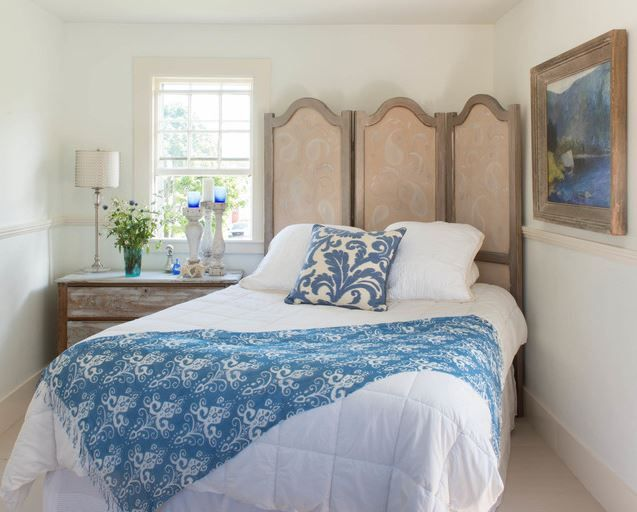 Bed Positioned On Angle In The Corner Of Small Bedroom Using A Folding