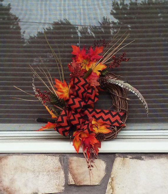 Check out this item in my Etsy shop https://www.etsy.com/listing/247867456/fall-floral-harvest-grapevine-wreath