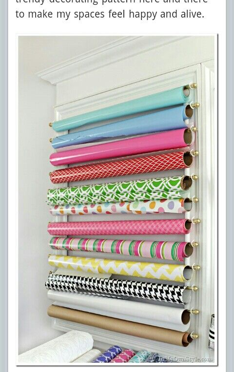 Nice Use Of Curtain Rods For Neatly Hung Paper Roll Storage.   From  Inmyownstyle.com