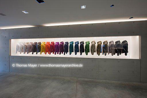 Generational illuminated wall display shoplifter for Milano design shop