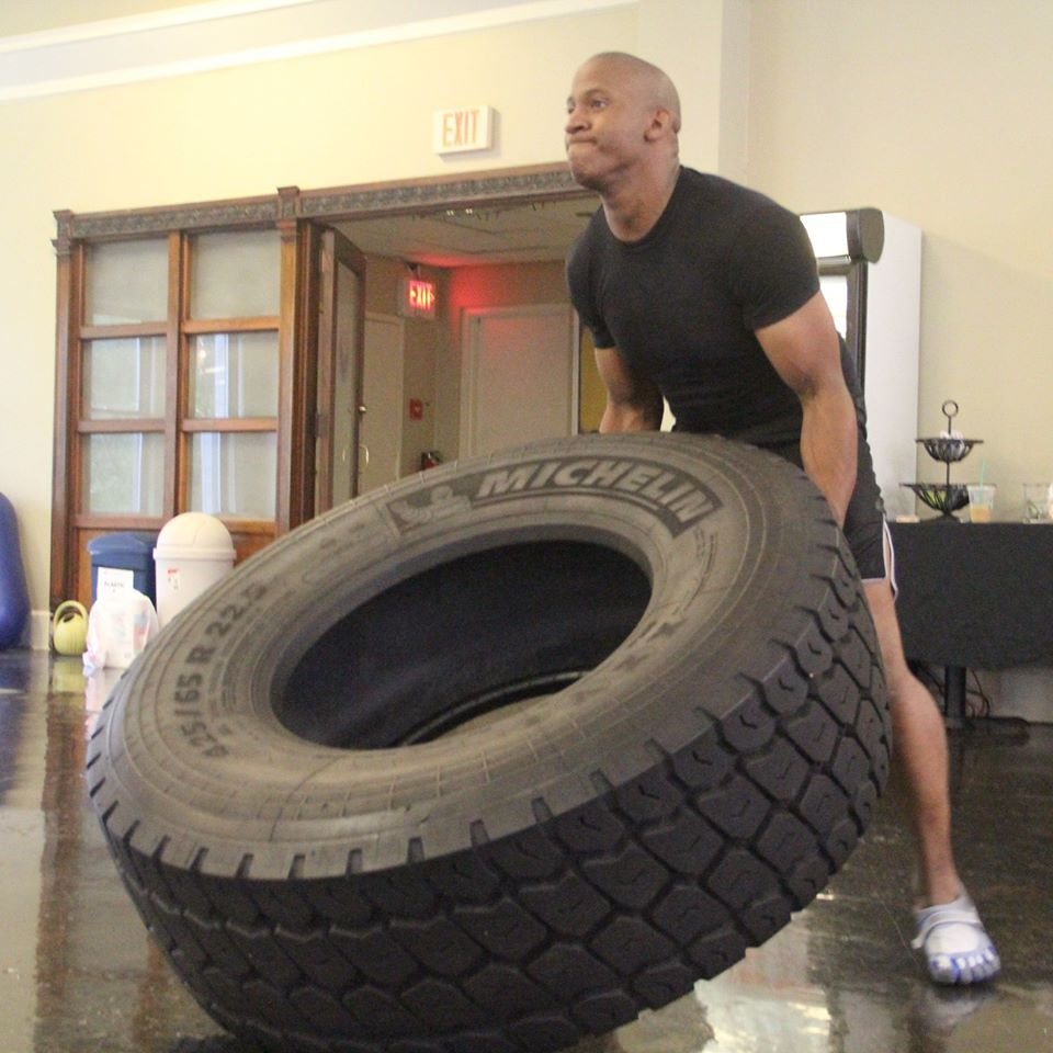 Rockin the tire lift at Envision - great body workout!