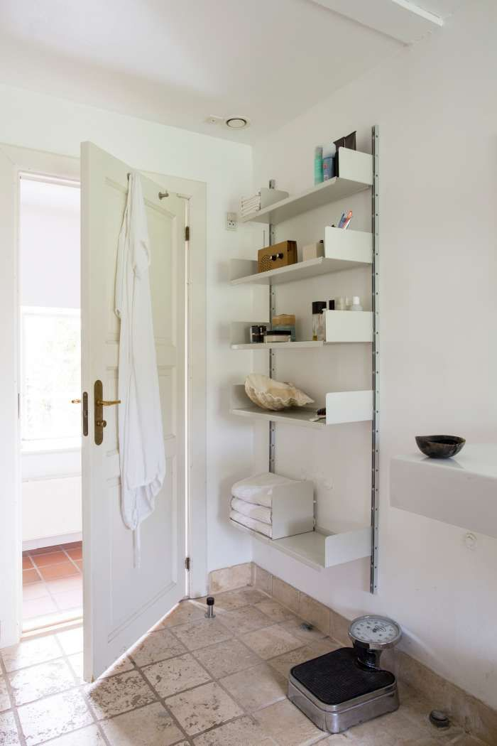 A Well Placed Door Stop Creates Viable Wall Space Behind Doors In A Bathroom Open Shelves Allow Towels To Breat Bathroom Storage Behind Door Storage Shelving