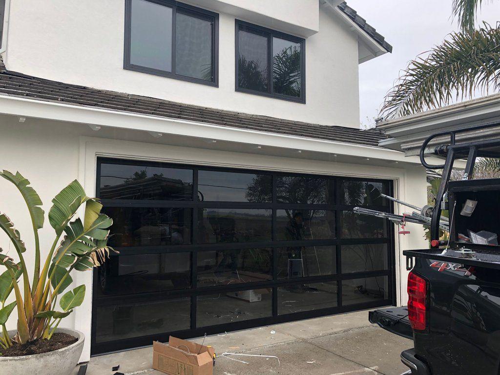 Contemporary Black Aluminum Gray Tinted See Through Glass Garage Door Modern Garage Doors Garage Door Design Garage Doors