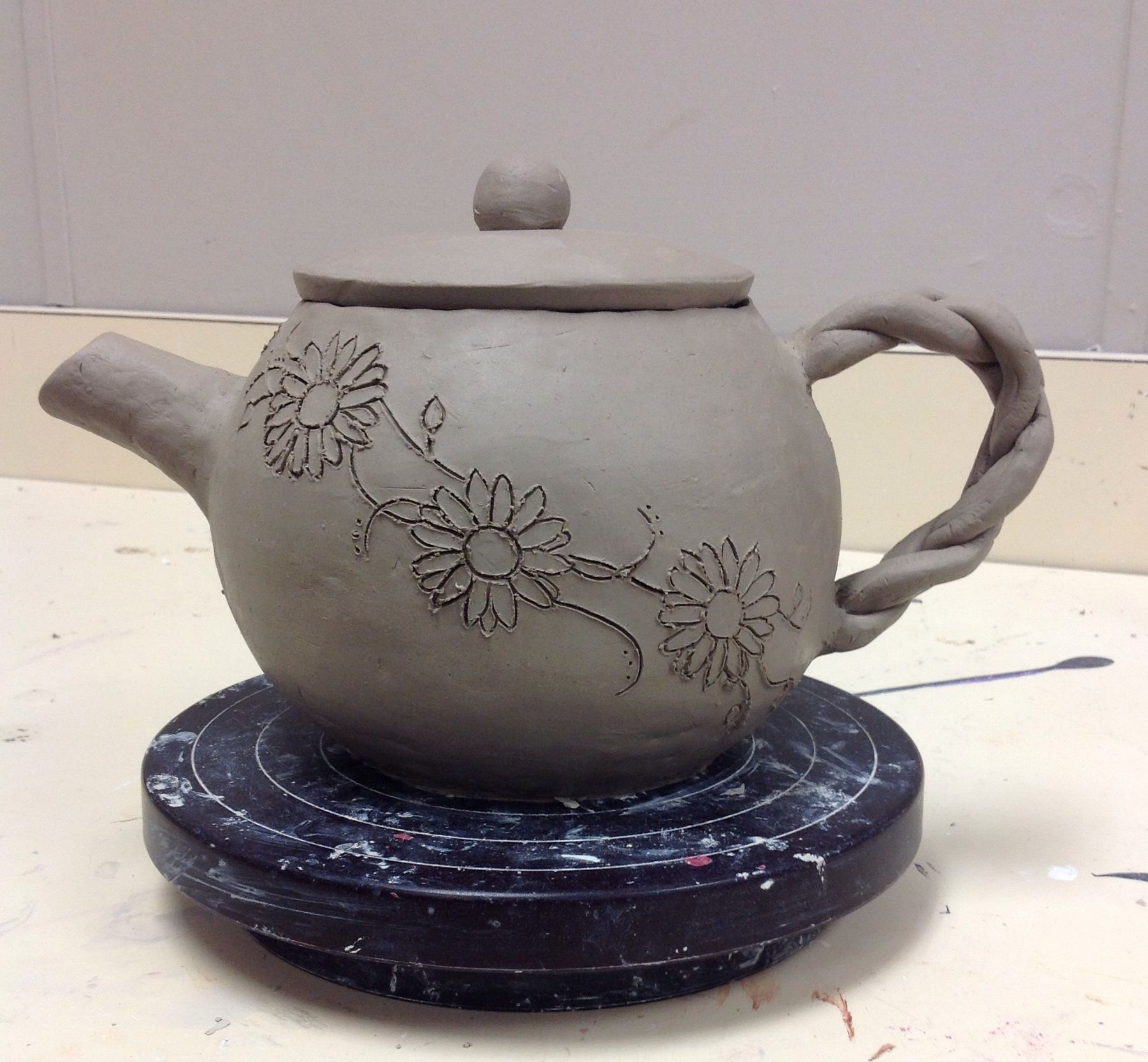 hand built ceramic tea pot still drying high school