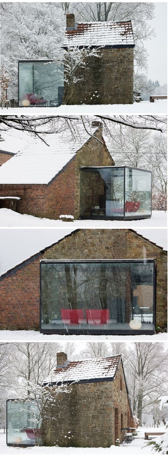 Old house and modern cube glass cohabitation