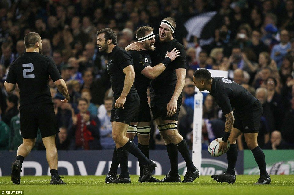 New Zealand second rower (second right) Brodie Retallick celebrates with his team-mates after scoring the first try of the quarter-final