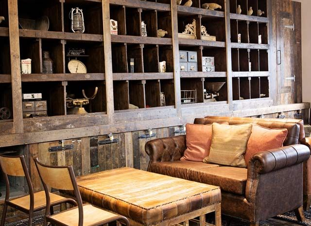 Create cottage style rooms with vintage seating seating for Interior leather bar