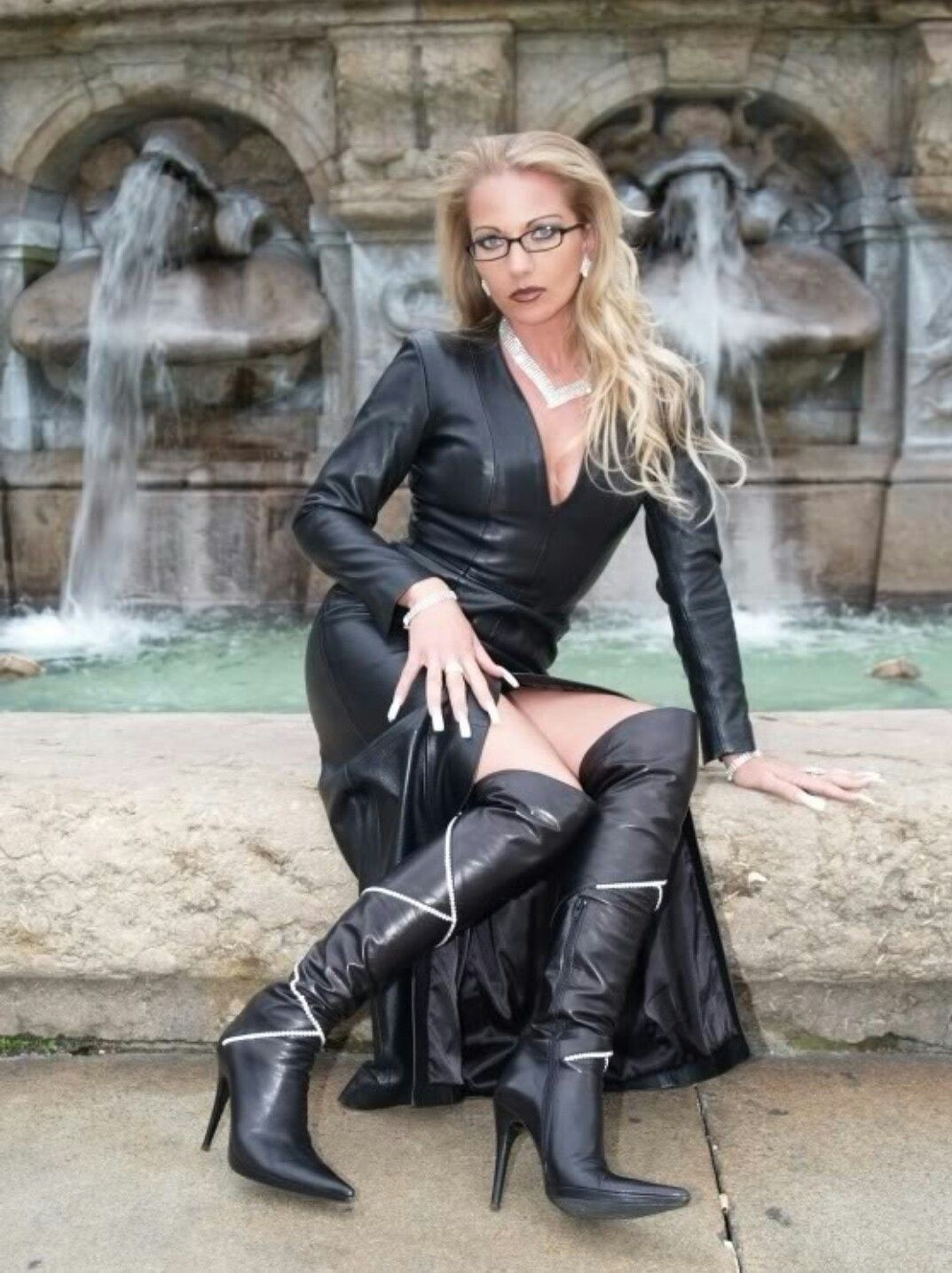 Heike - Fetish Queen in Black Leather V Neck Long Dress and Boots Knee Boots .