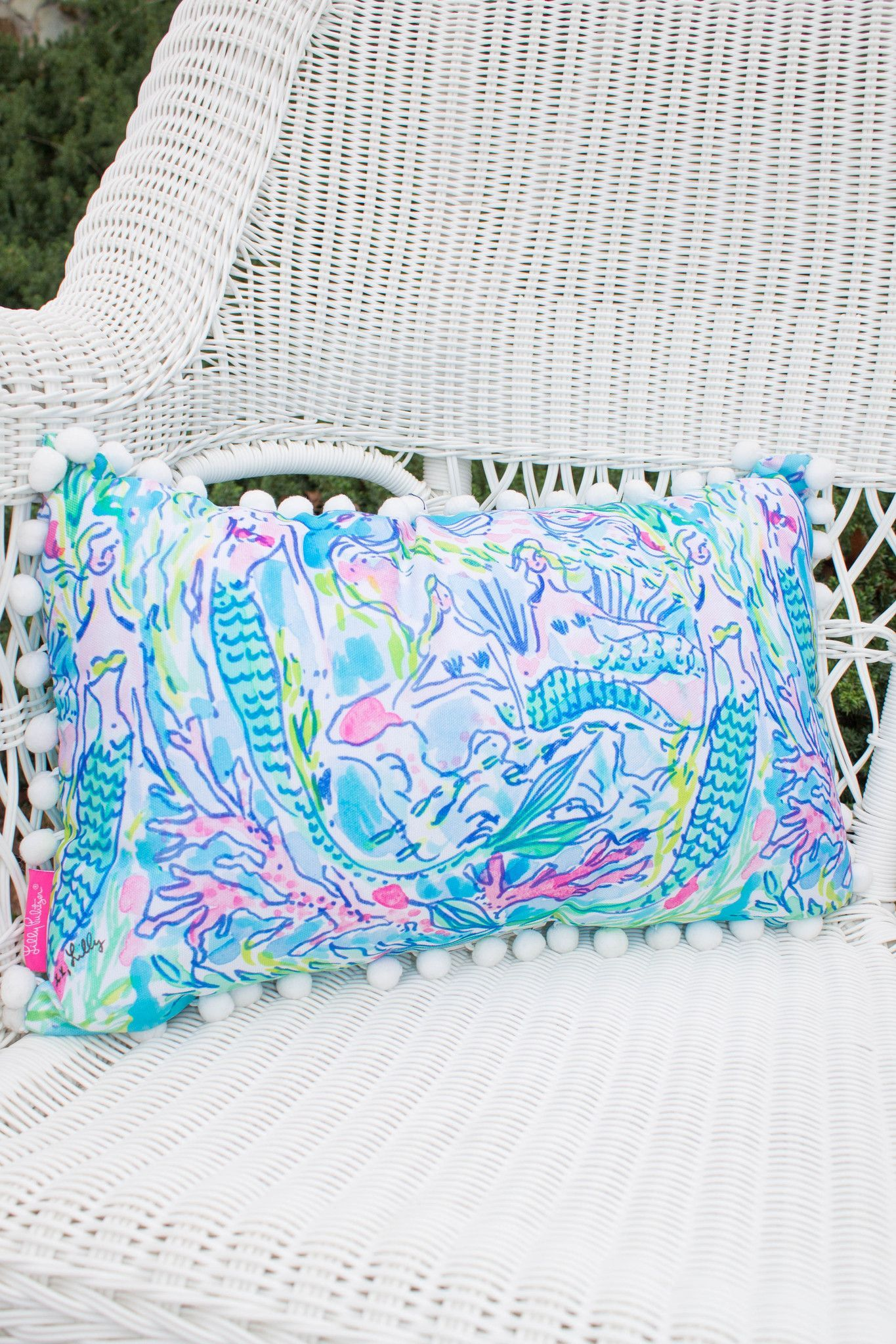 Preppy Lilly Pulitzer mermaid pillow is going to look so cute in your bedroom or on your front porch rocking chair! Perfect pillow for any Lilly lover. Pillow is framed with fun white pom-poms. Weathe