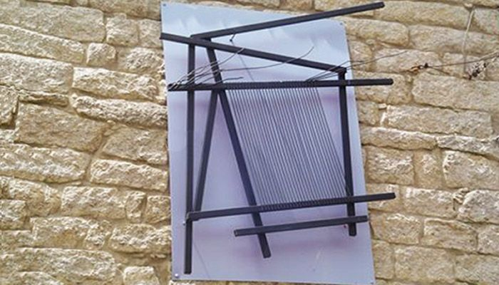 #Whattosee in #Sardinia: #Aggius and the art of #weaving. The looms made by #MariaLai in 2008 as part of the Essere è Tessere (To be is to Weave) project: frames arranged on aluminum panels representing the warp and weft of the frames and their threads, a symbol of the identity of this community. #art #artist #italy