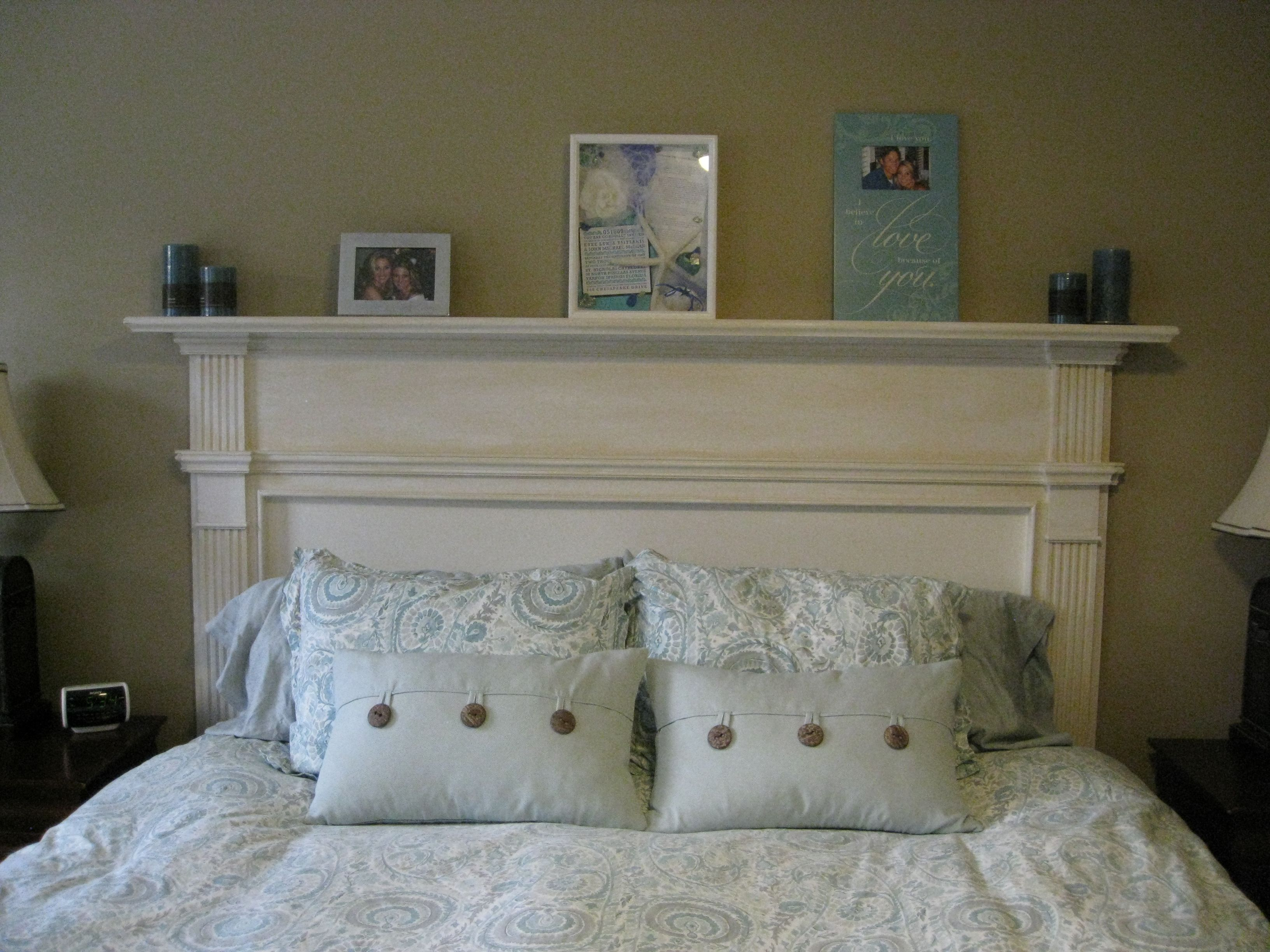 I made an old fireplace mantle into our headboard in the master