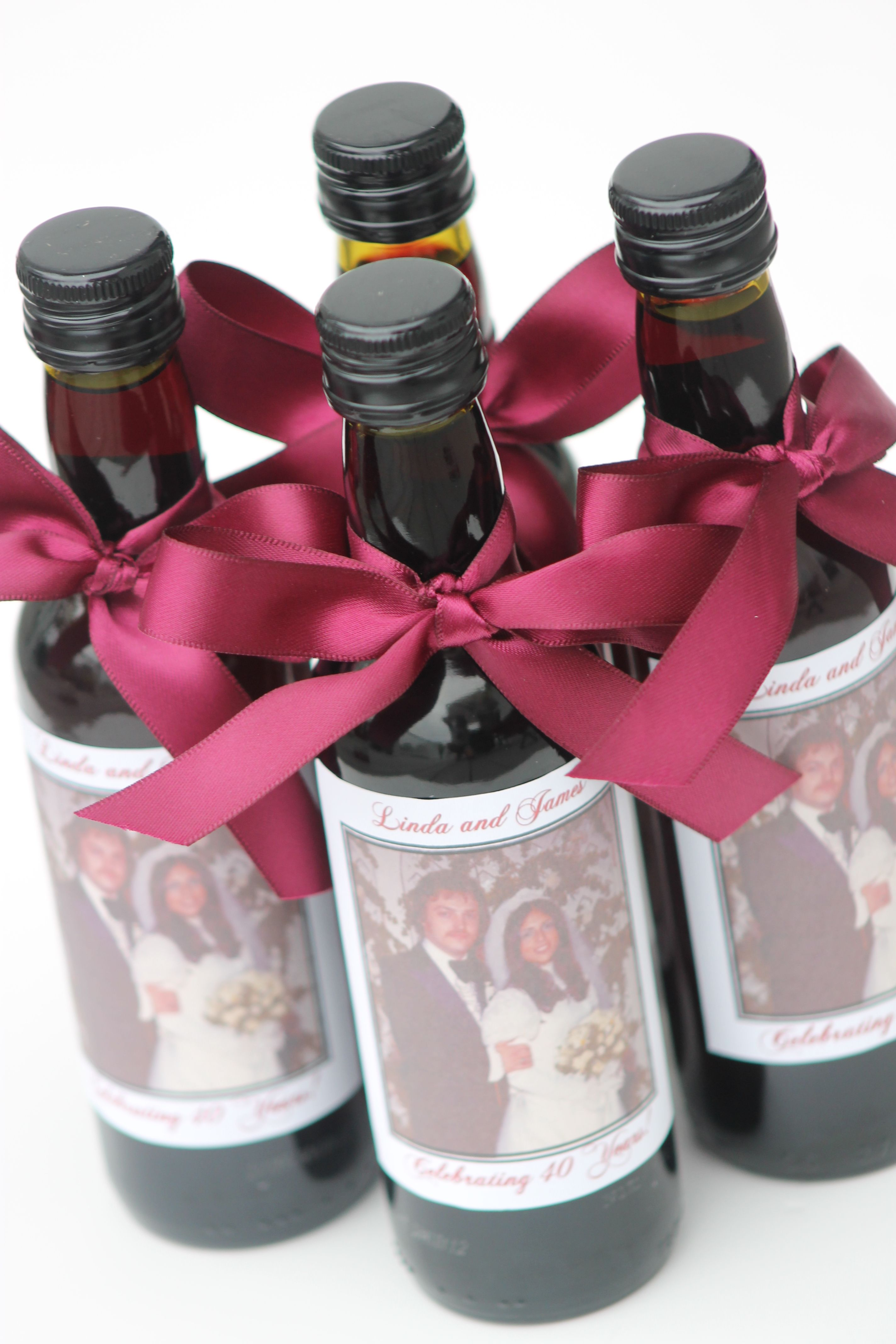 Wine bottle favors... available at https//www.facebook