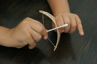 Awesomeness... tiny bow & arrow made from a popsicle stick, dental floss and a cotton swab! LOVE this!