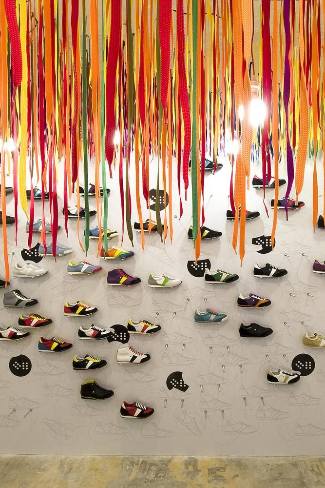Botas 66, a high concept shoe store in Prague. Shoe laces are suspended from the ceiling.